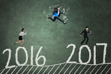 Three workers running to reach 2017