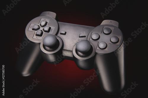 Poster wireless black joypad - joystick / portrait of a wireless joypad for console