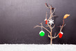 naked tree with a leaf, mittens, boot, snowflake and Christmas b
