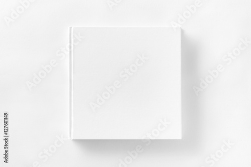 Mockup of closed blank square book at white textured paper Poster