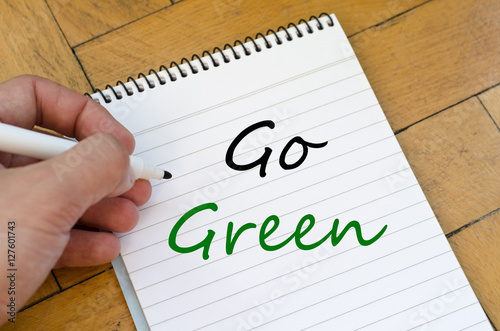 Poster Go green concept on notebook
