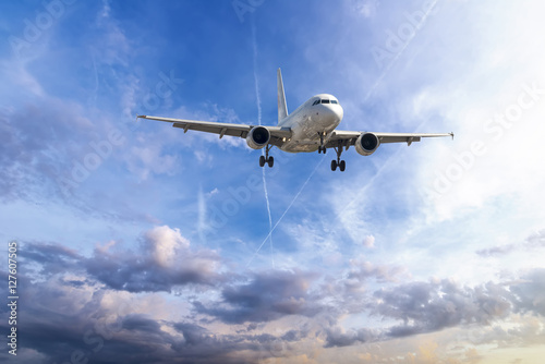Poster Passenger plane take off from runways against beautiful cloudy s