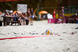 Beach volleyball ball on the playing ground