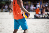 Man with volleyball ball on the playing ground