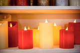Multi-colored candles are arranged in a single row.