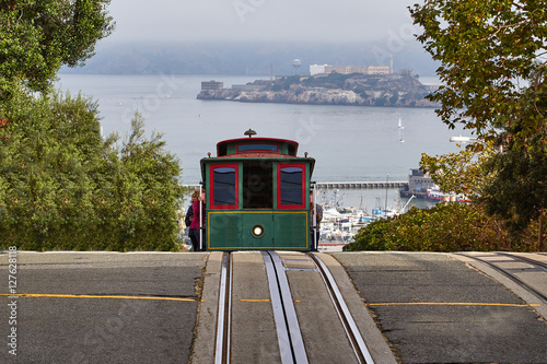 A cable car cresting a hill in San Francisco Poster