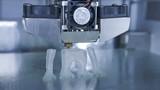 3D printer print the human like monkey using plastic filament