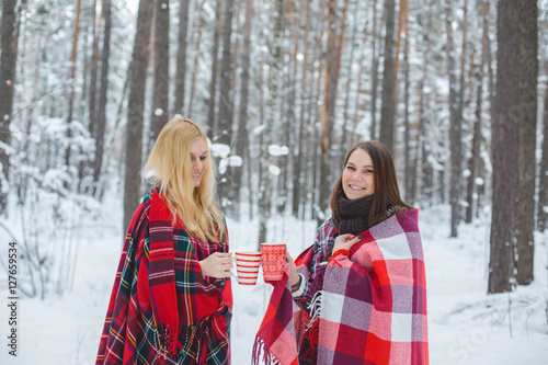 Poster two girls sheltered red plaid hold mugs