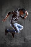 Man break dancing on wall background