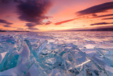 Fototapety Colorful sunset over the crystal ice of Baikal lake