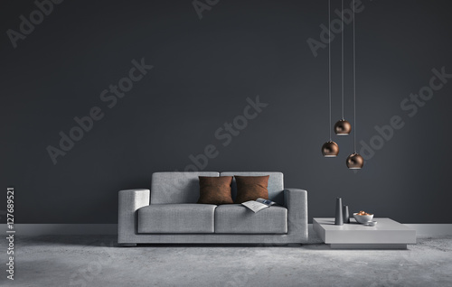 Sofa vor dunkelgrauer Wand