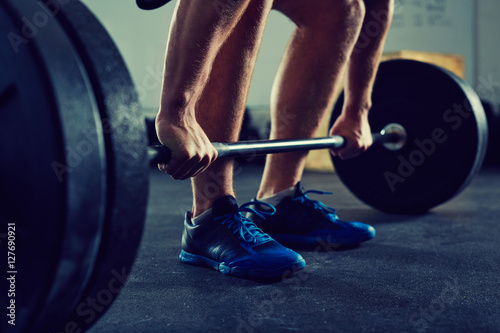 Póster Closeup of muscular man doing deadlift exercise at gym - fitness, healthy lifest