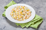 Salad with crab sticks, corn, cucumber, and eggs