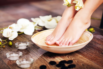 Closeup photo of a female feet at spa salon on pedicure procedur