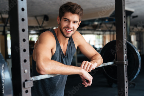 Beautiful fitness man with weights
