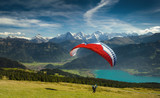 Fototapety Paraglider taking off in front of spectacular Swiss scenery, Bernese Oberland, Switzerland.