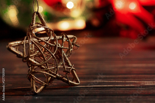 christmas golden star on background of garland lights on black r