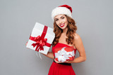 Smiling girl with red and white gift box