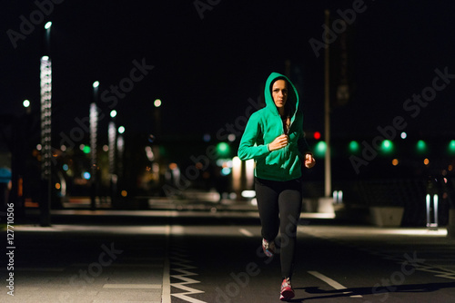 Deurstickers Jogging Jogging at night. Woman jogging late at night
