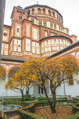 Poster church Santa Maria Delle Grazie in Milan, Italy, from courtyard vertical view