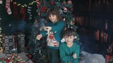 Kids having fun with petards near dressed up christmas tree