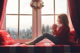 girl sitting by window
