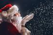 Santa Claus blows snow.