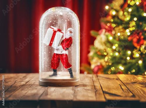 Poster Santa inside a Christmas snow globe.