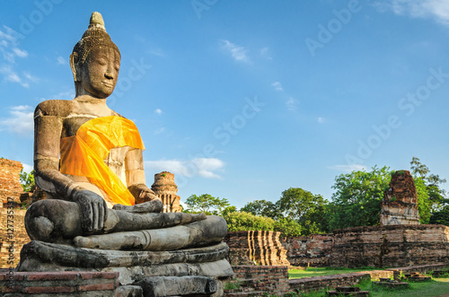 Ayutthaya (Thailand), giant Buddha statue in an old temple ruins