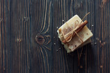 Bars of handmade soap over dark wood background. Top view.