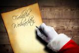 Weihnachtsmann beginnt einen Brief mit der Überschrift