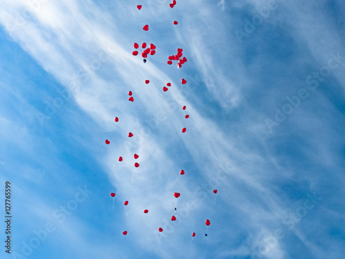 Countless red love balloos flying to heaven against sky background Poster