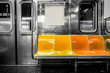 New York City subway car interior with colorful seats - 127769559