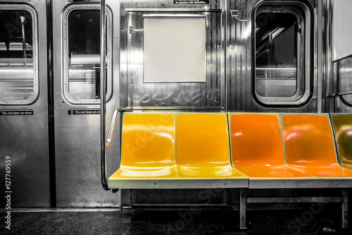 Foto Murales New York City subway car interior with colorful seats