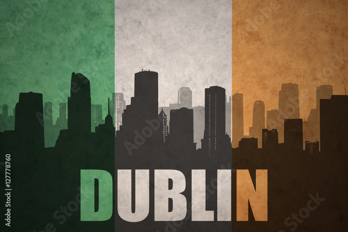 Poster abstract silhouette of the city with text Dublin at the vintage irish flag