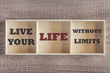 Live your life without limits. Motivational quote written on wooden box