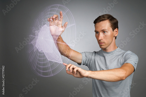 Poster Man working with interactive Sci-Fi HUD interface.