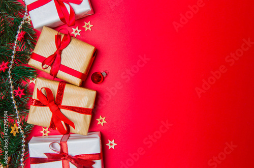 Poster Christmas red background with tree, gift and decoration