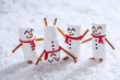 Happy funny marshmallow snowmans on snow