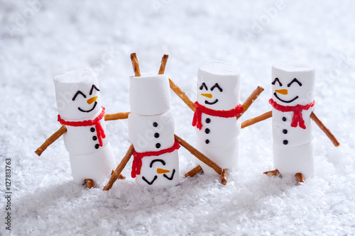 Happy funny marshmallow snowmans on snow Poster