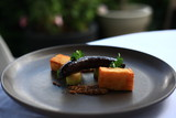 Black pudding sausage with mille feuille potato, leek and grainy mustard