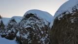 Rolls of hay under the snow. Sunset. Slider. 4K