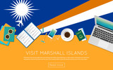 Visit Marshall Islands concept for your web banner or print materials. Top view of a laptop, sunglasses and coffee cup on Marshall Islands national flag. Flat style travel planninng website header.