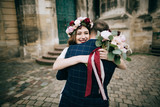Happy Bride and groom embracing and walking in the  old city in Europe. wedding concept