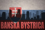 abstract silhouette of the city with text Banska Bystrica at the vintage slovakia flag