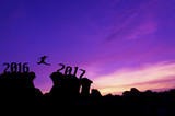 Silhouette man jumping between 2016 and 2017 years.