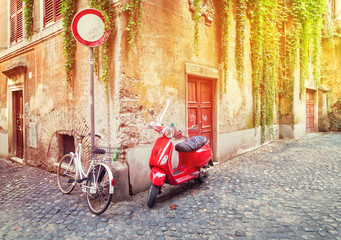 old town italian street with byke in Trastevere with sunshine, Rome, Italy