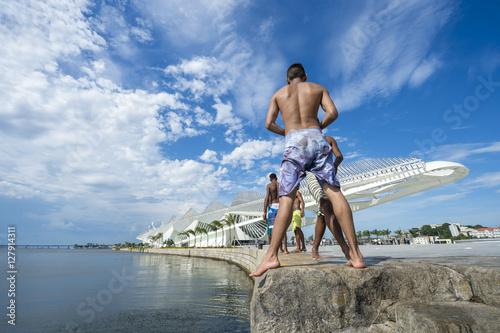 Poster Brazilians diving into Guanabara Bay in the regenerated port area of Porto Marav