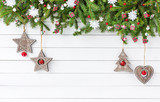 Christmas background. Christmas fir tree with decoration on white wooden board background. Top view, copy space