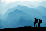 Climbers in the mountain range background